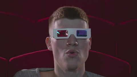 Man in 3d glasses eating popcorn wathing cinema Footage
