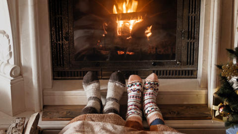 4k footage of romantic couple in socks warming at burning... Stock Video Footage