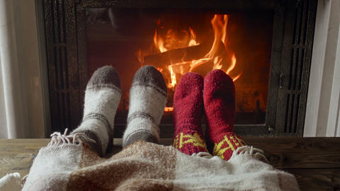 4k video of couple in love wearing knitted woolen socks lying under blanket next Live Action