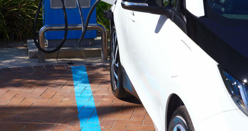 Electric car charging at charging station 4k Live Action
