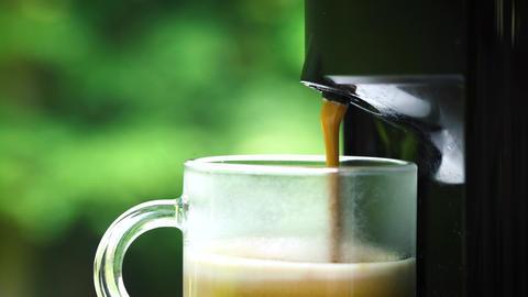 Making espresso coffee in a natural landscape GIF