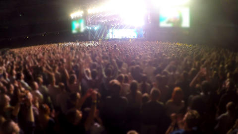 Crowd of people putting hands in air and clapping, fans at concert, stadium Footage
