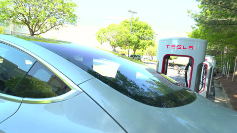 Charging a Tesla Model 3 at a Tesla Supercharger station in Raleigh, NC Live Action