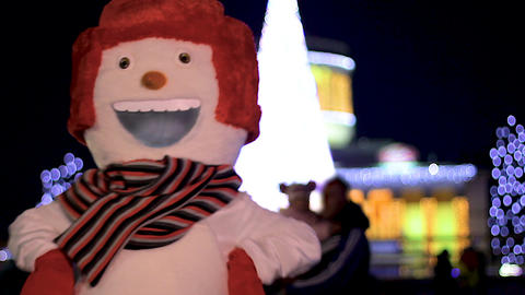 Amusing snowman funny dancing against backdrop of Christmas tree, good mood Footage
