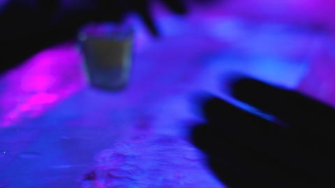 Barman skillfully serving icy glass with shot to client of creative ice bar Live Action
