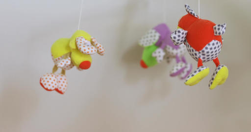 baby mobile with blue hand-stitched animal Archivo