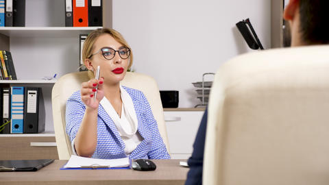 Woman wearing glasses taking a job recruitment interview Live Action