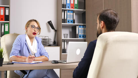 Human resource woman worker interviewing a male candidate Footage