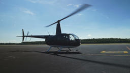 Helicopter on a Runway Side View Live Action