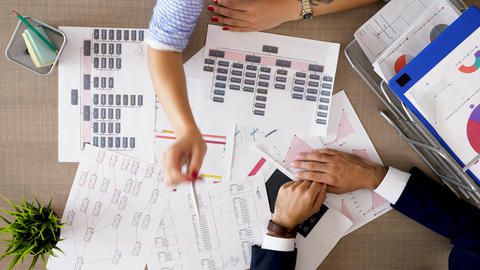 Corporate financial team analyzing charts and diagrams with market sales Footage