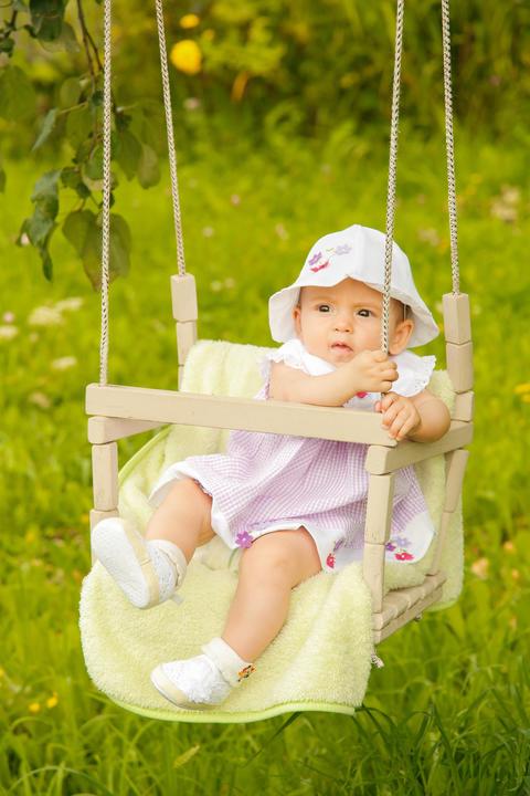 Little baby in Panama swinging on a swing Photo