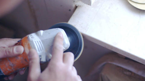 The worker carefully processes the marble window sill. Quality repair of Footage