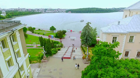 Aerial View. Beautiful view of the city, the embankment and the blue lake GIF