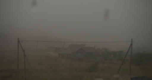 Strong hurricane Downpour with hail Zero visibility in bad weather over the Footage