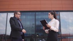 Businessman shaking hands with business girl. 4K Footage