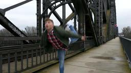Street Dance Beside Moving Train on City Bridge Footage