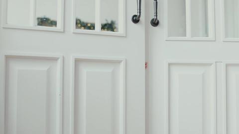 Children peeking out of the open room door Footage