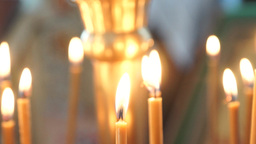 Burning candles during the Liturgy in an Orthodox Christian Church Footage