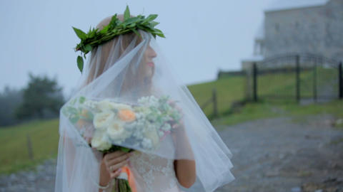Romantic and mysterious image of the bride under a veil in the background of a Footage