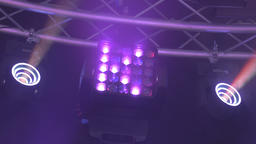 Led Stage Light Shining Different Colors and Spinning Live Action