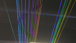 Streaks of Laser Lights Criss-Crossing, Expanding, and Collapsing Footage