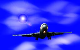 Realistic airplane on a background of blue sky with clouds Vector Vector