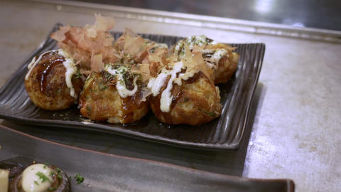 Takoyaki, or Octopus Balls Japanese best-known street food Footage