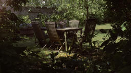 Wooden Garden Furniture in Lush Green Backyard Footage