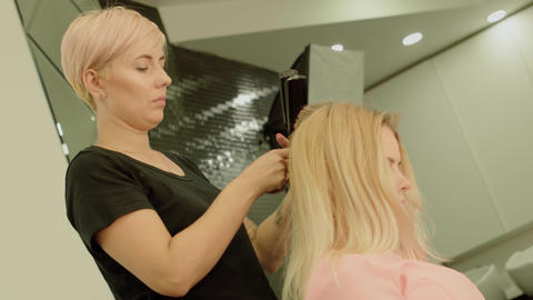Beautiful young girl in a beauty salon Stock Video Footage
