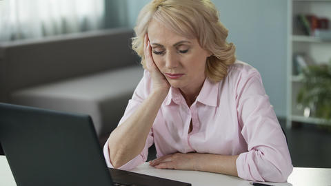 Mature woman falling asleep at workplace, lack of vitamins and energy, tired Footage