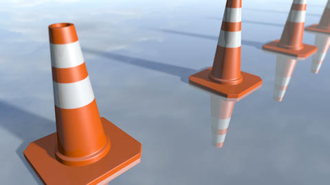 Animated traffic cone pilons in a row. 3D rendering 4K Animation