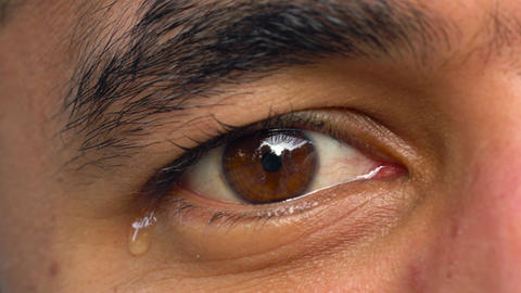 Beautiful eye of a man of Arab nationality close-up. The man is crying Footage