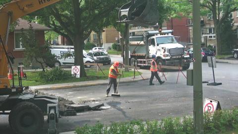 City worker sweeps debris on road Footage