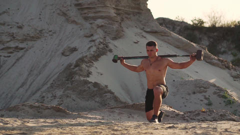 Sport Fitness Man Hitting Wheel Tire With Hammer Sledge Cross fit Training Footage
