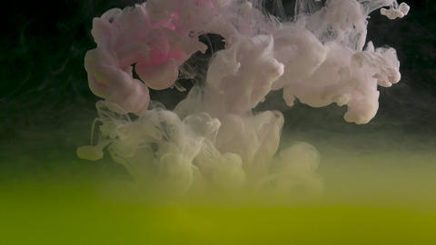 Color drop underwater creating a silk drapery. Ink swirling underwater Footage