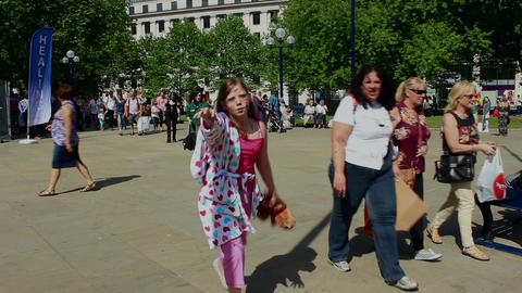 Zombie teenage girl, with a teddy bear in her hand, walking toward camera - slow Footage