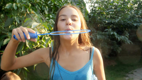 Slow motion video of happy smiling bruntte girl blowing... Stock Video Footage