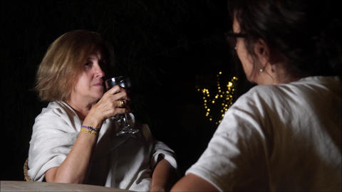 Two middle aged women chatting at the patio Footage