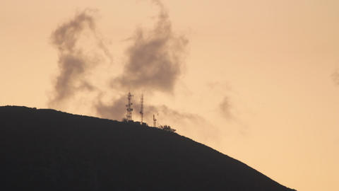 Wispy clouds - Radio/weather Tower - Silhouette at Dawn Footage