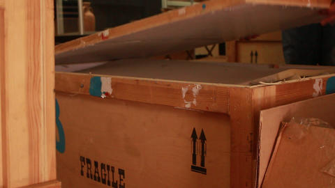 Shipment delivery logisics worker is opening cargo container box in the storage 영상물