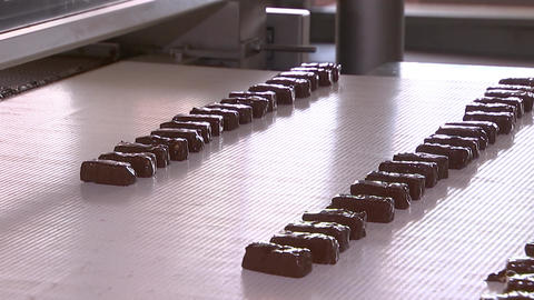 Chocolates are moving along the conveyor belt Footage