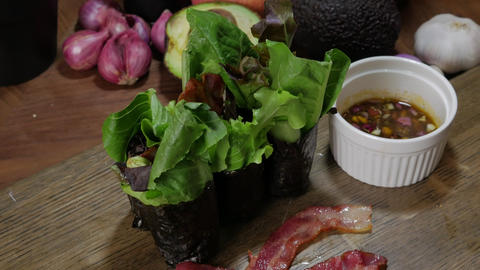 mixed seaweed salad roll with avocado bacon Live Action
