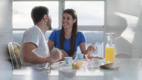 Young Couple Eating Breakfast At Home On Sunday GIF