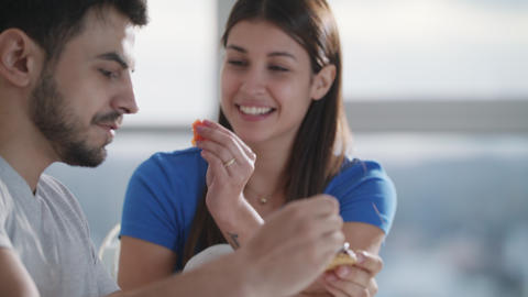 Young Couple Eating Breakfast At Home On Sunday Archivo