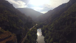 Bright Sunshine Over Hillside Forest and River Footage