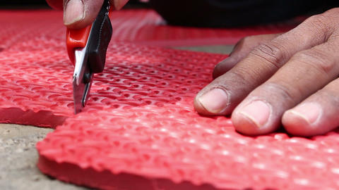 hands cutting EVA foam Footage