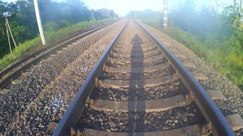 Shadow of a man walking on a railway Archivo