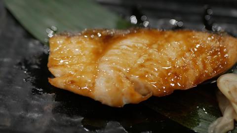 Teriyaki salmon. grilled salmon fillet glazed in soy sauce Live Action