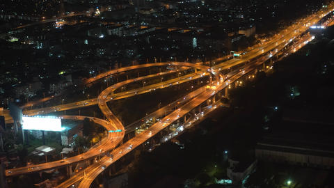 movement of cars in the highway and the bridge in the nighttime big city. view Footage