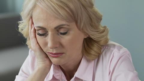 Overworked mature woman sleeping at workplace, lack of sleep and vitamins Live Action